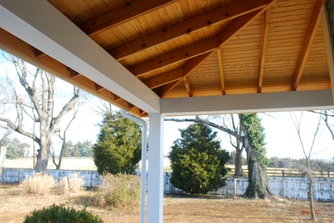 Wrap around porch with exposed cedar framing