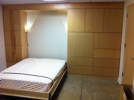 Murphy bed pulls down with LED octopus arm reading lights.