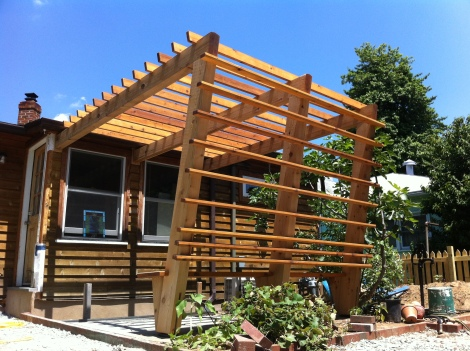 Beautiful all cedar pergola built in the city with blue stone patio and built in bench.